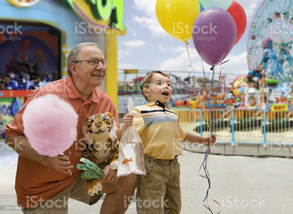 Boy and Grandfather in a Fair stock photo