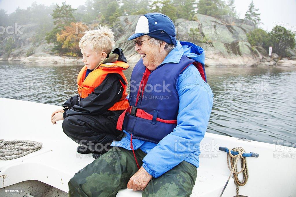 boy and grandma on boat royalty-free stock photo