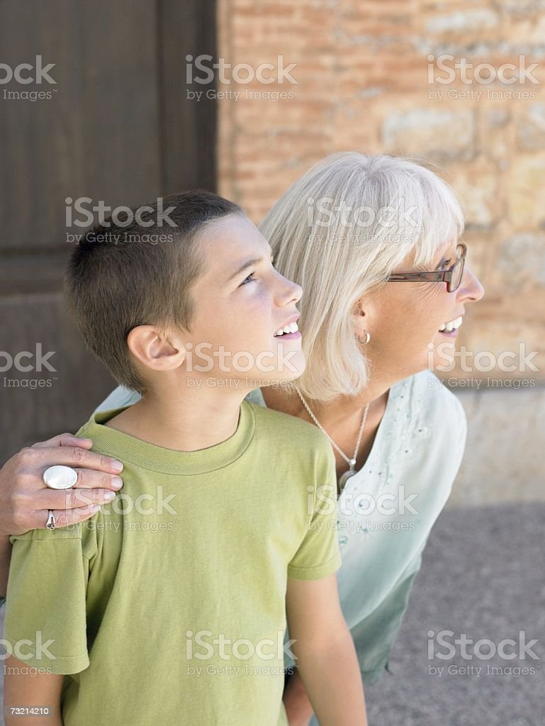 Boy and grandmother looking away stock photo