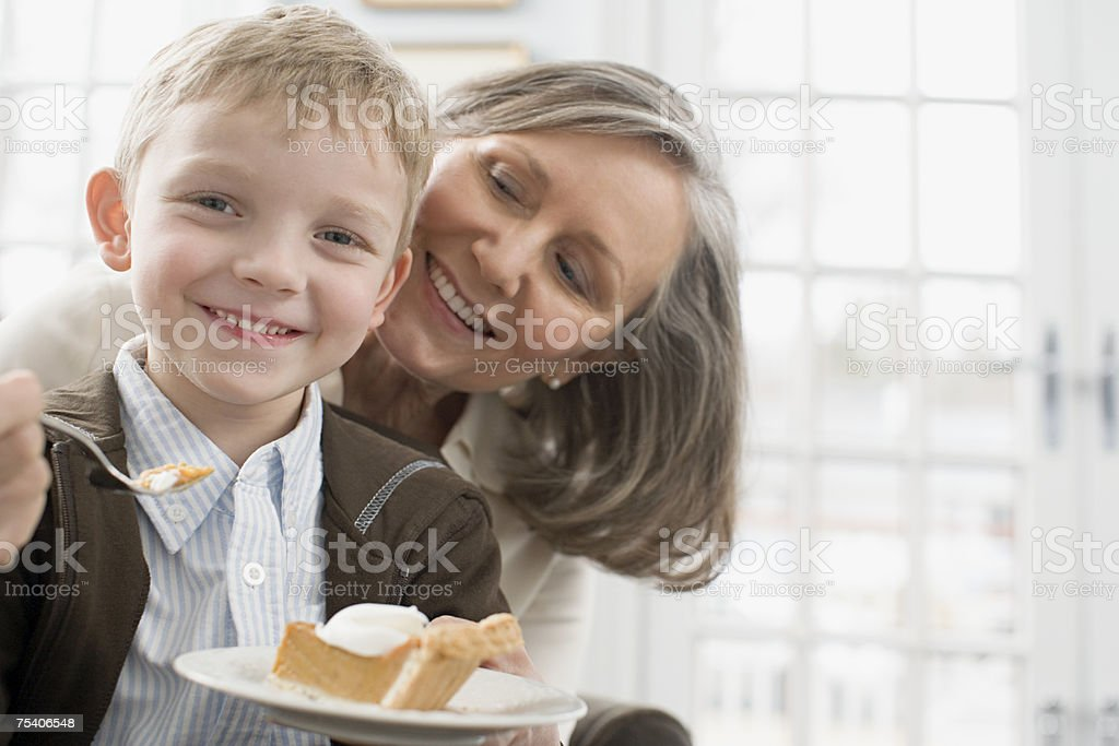 Boy and grandmother with pie stock photo