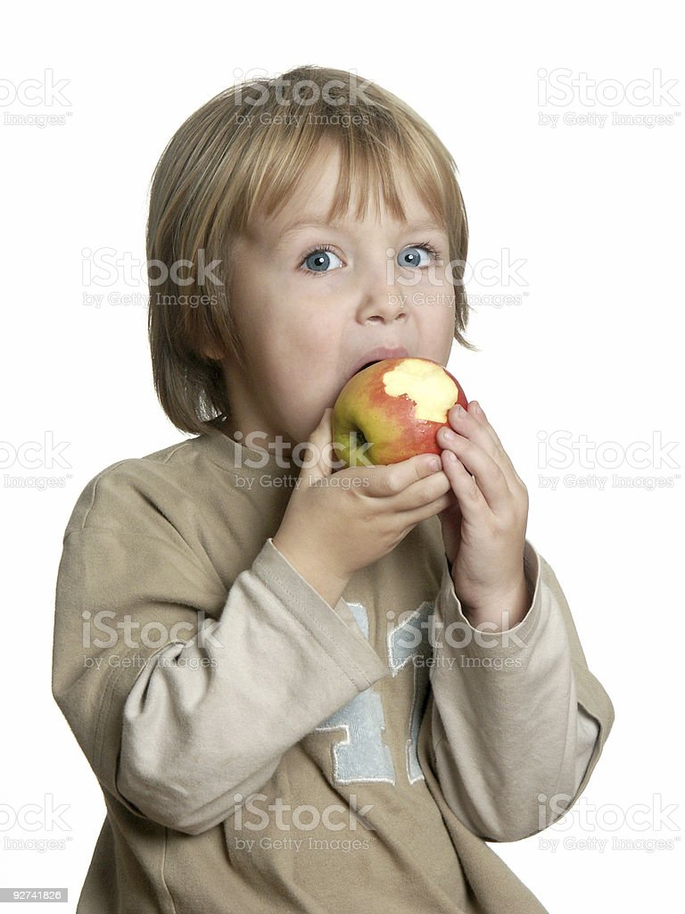 Boy and his Apple stock photo