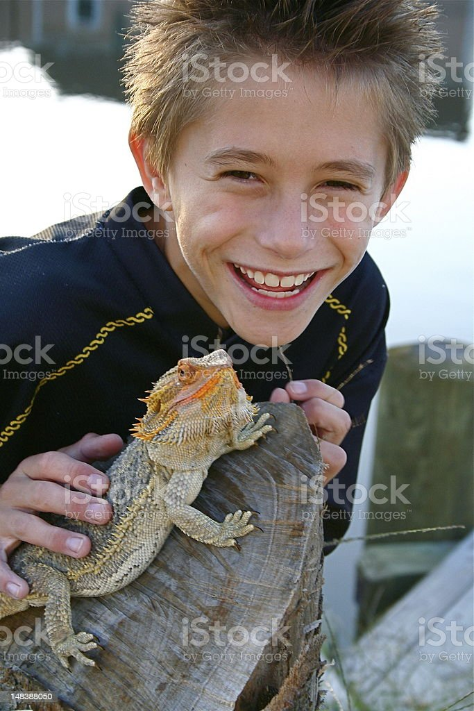 Boy and his Bearded Dragon stock photo