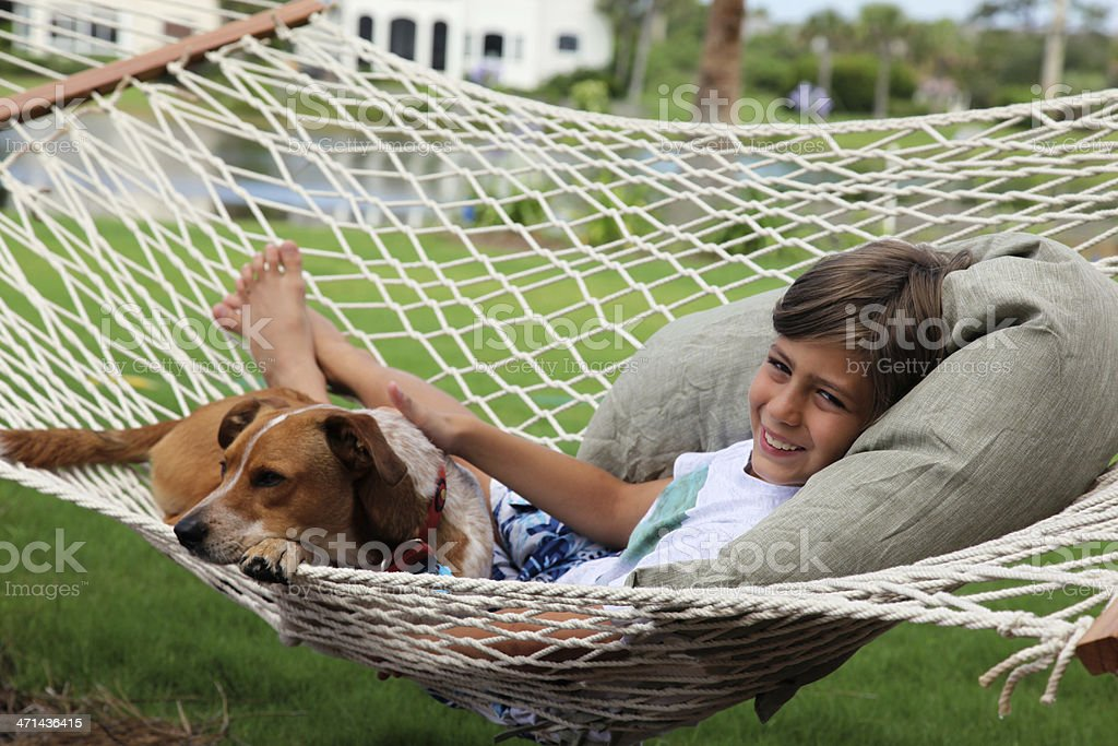 Boy and his Dog relaxing in Hammock royalty-free stock photo