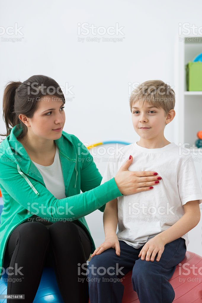 Boy and his physiotherapist stock photo
