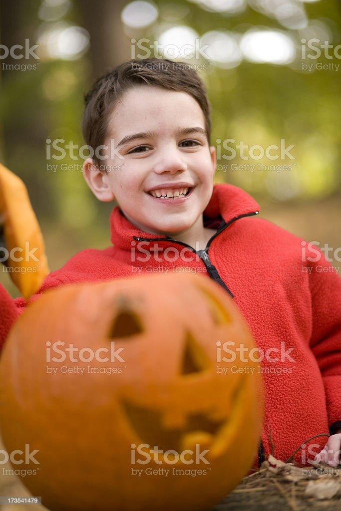 Boy and Jack O'Lantern stock photo