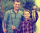 Boy and man fishing