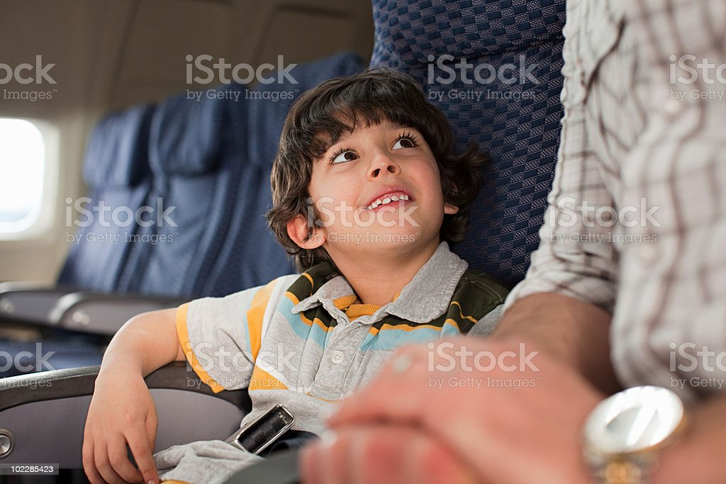 Boy and man on an airplane royalty-free stock photo