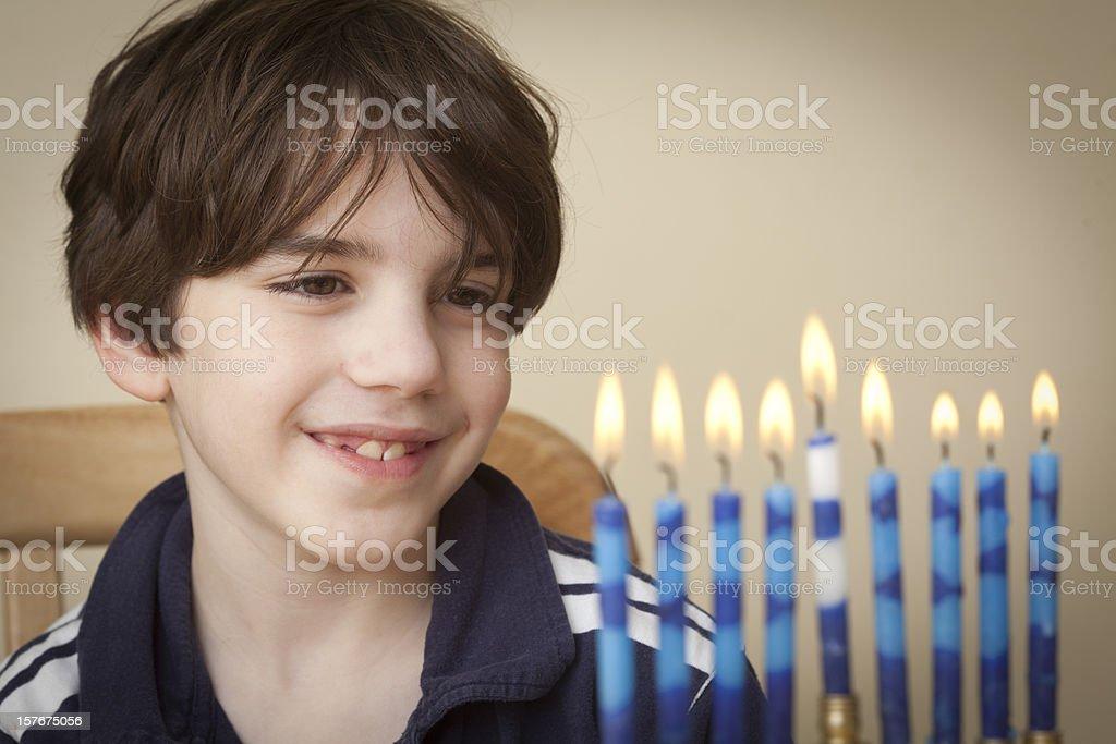 Boy and Menorah stock photo