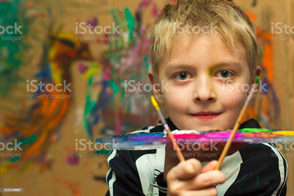 Boy and paints stock photo