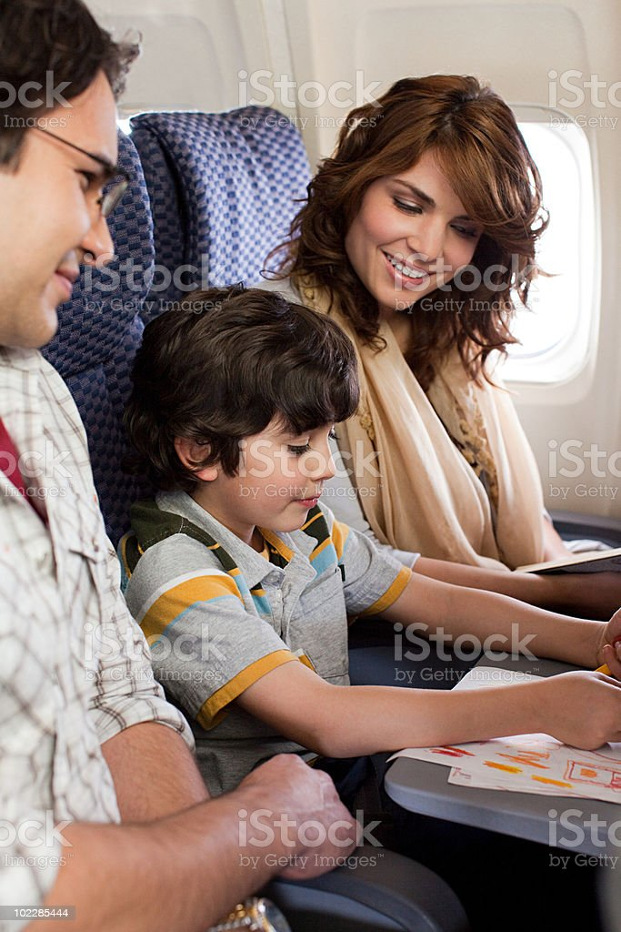 Boy and parents on airplane royalty-free stock photo