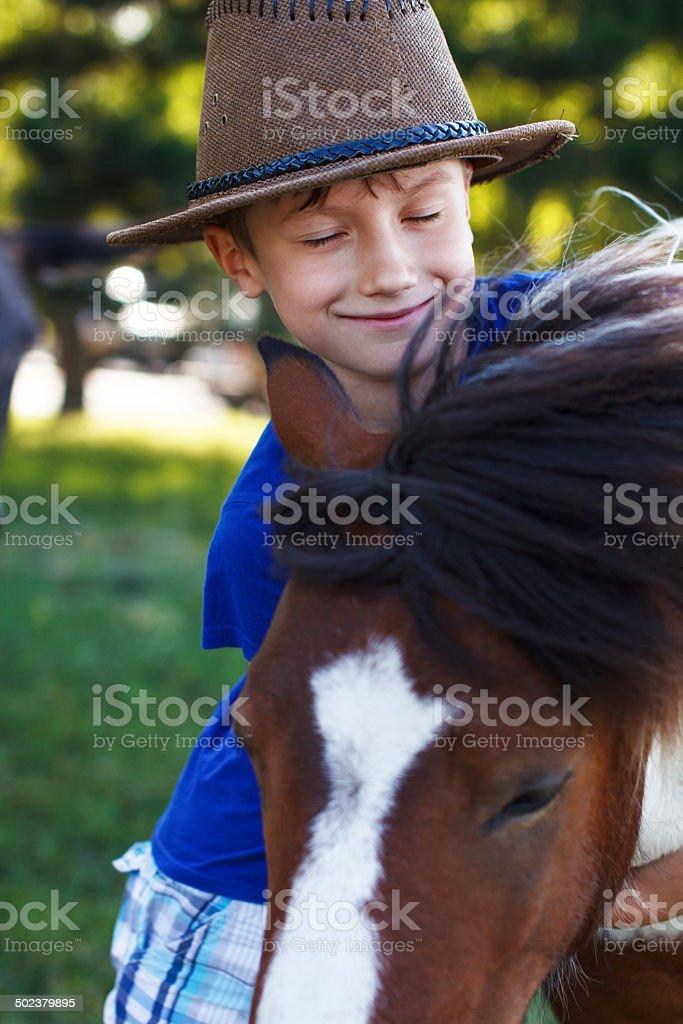 Boy and pony royalty-free stock photo