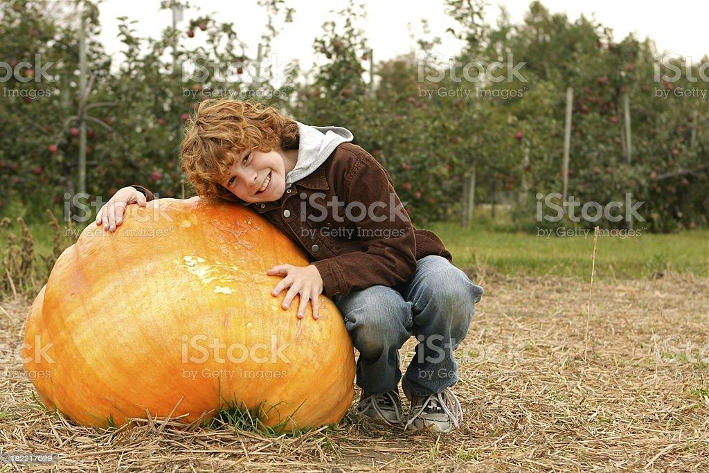 Boy and Pumpkin royalty-free stock photo