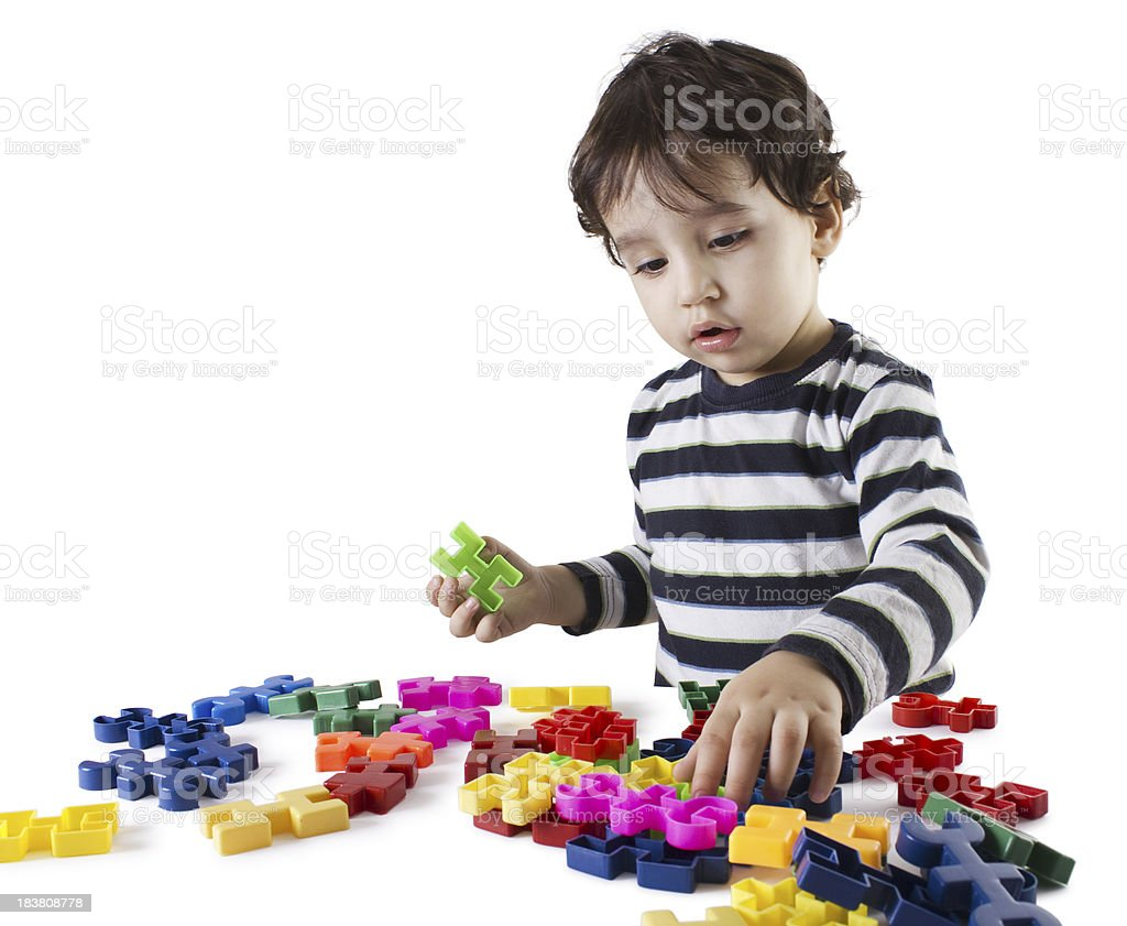 Boy and puzzle royalty-free stock photo