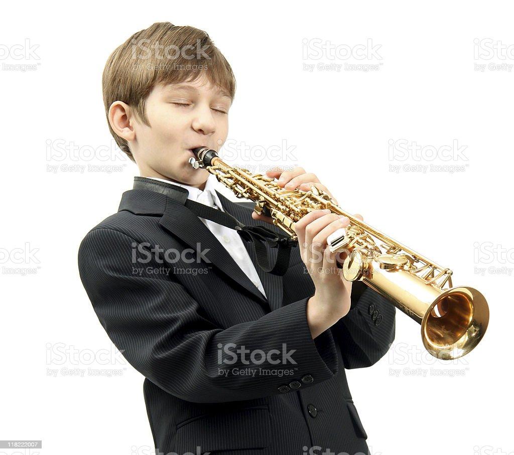 Boy and saxophone stock photo