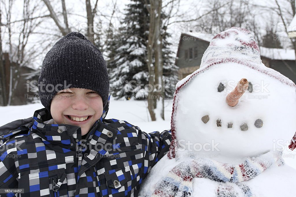 Boy and Snowman royalty-free stock photo