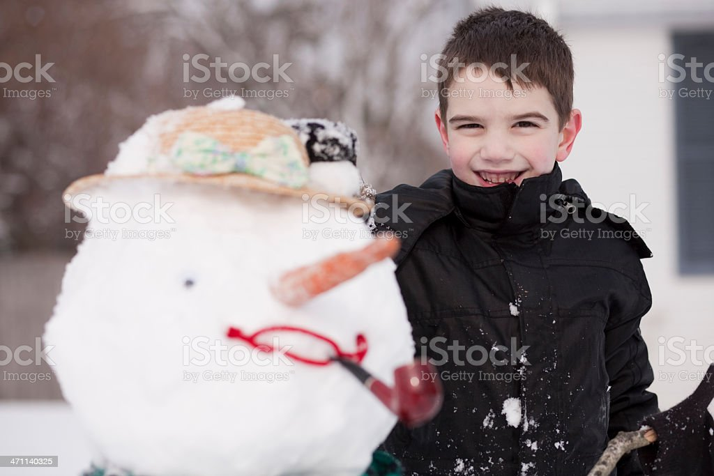 Boy and snowman stock photo