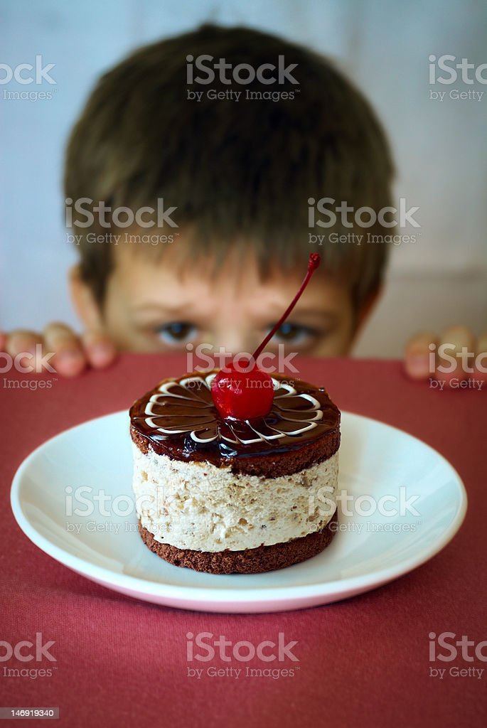 Boy and sweet cake. stock photo