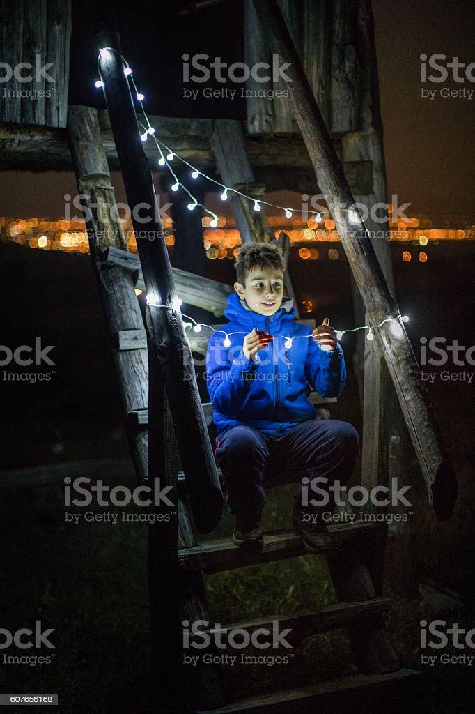 Boy and the light bulbs stock photo