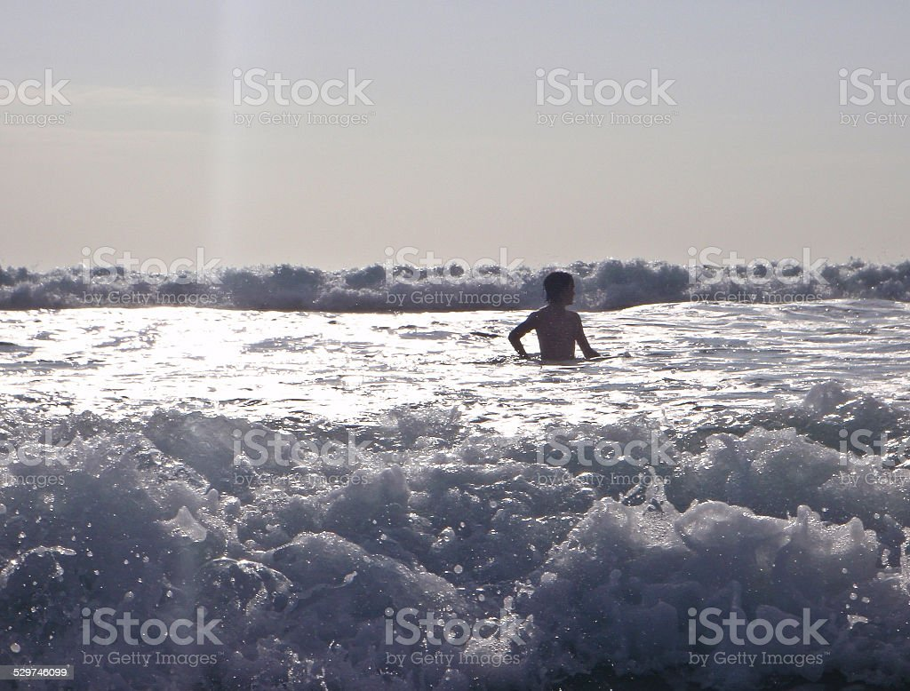 Boy and Waves stock photo