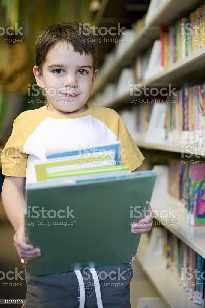 Boy at library stock photo