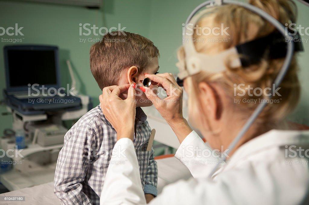 Boy at otolaryngologist's office stock photo