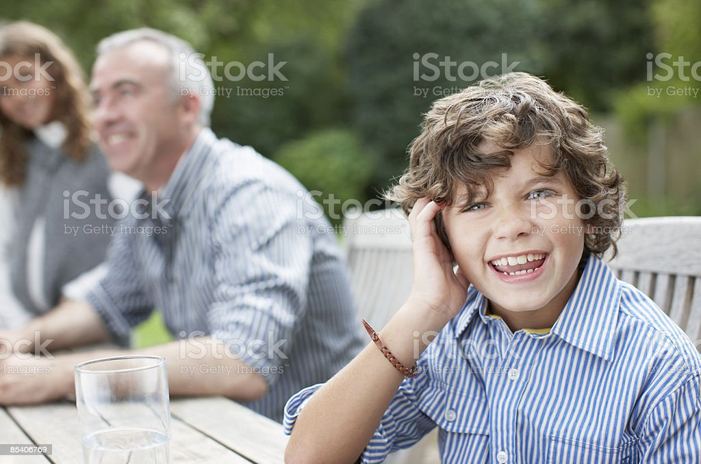Boy at picnic table with family royalty-free stock photo