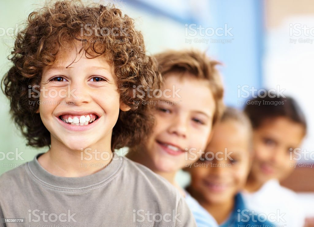 A boy at school with his peers behind him royalty-free stock photo