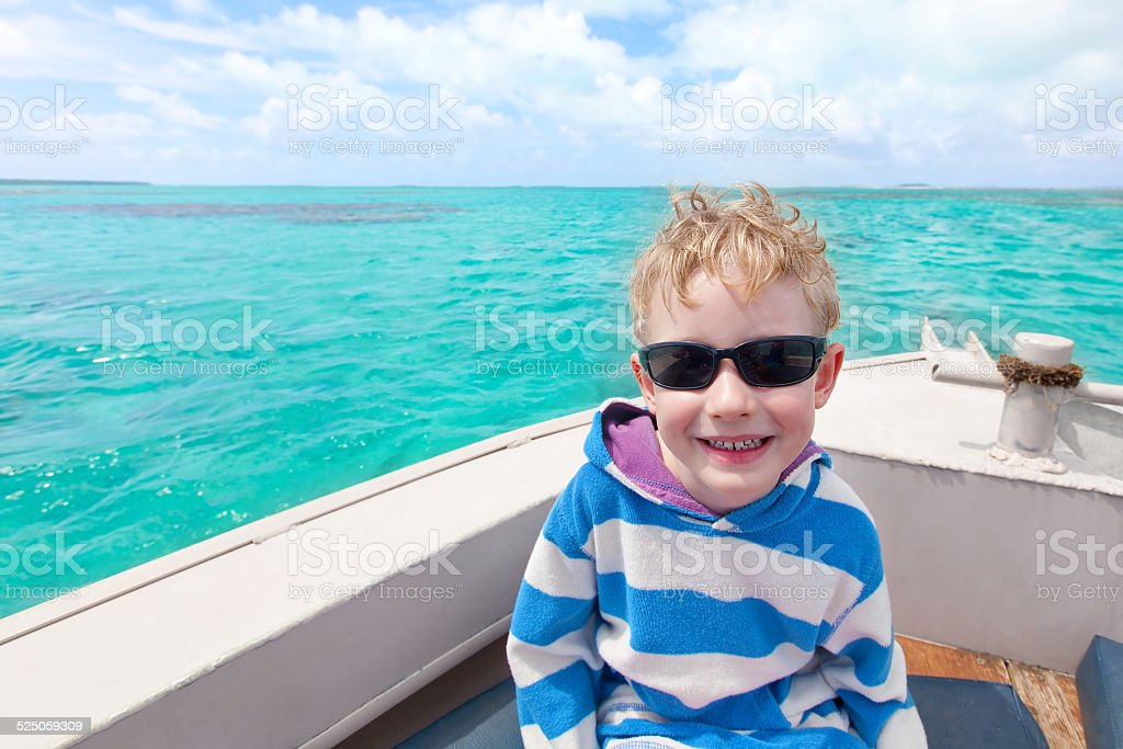 boy at sea stock photo