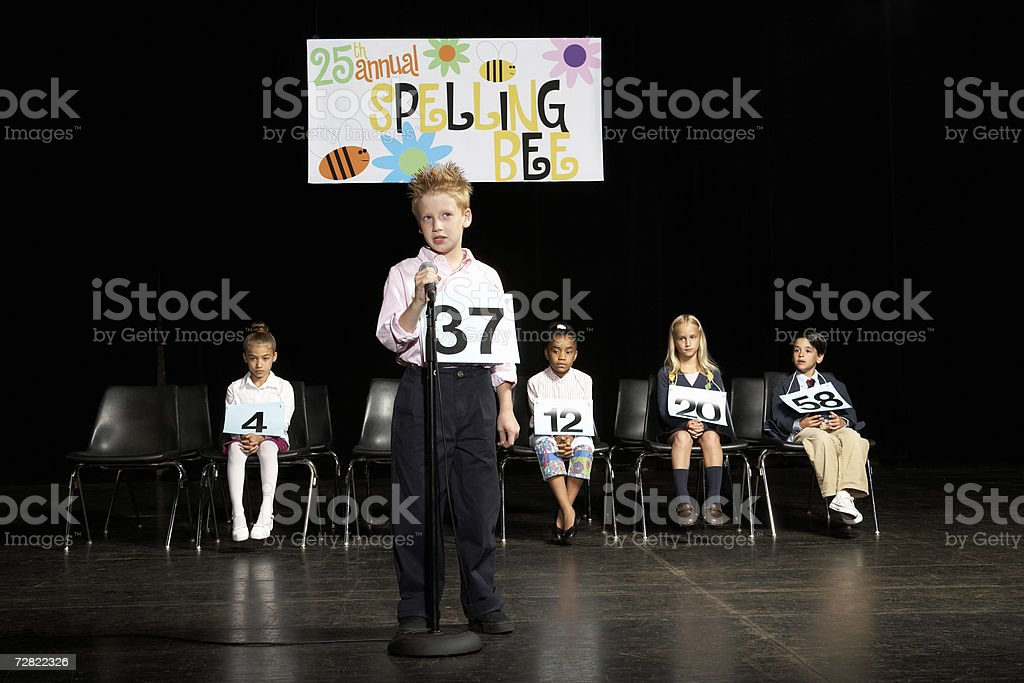 Boy (8-9) at spelling bee competition stock photo