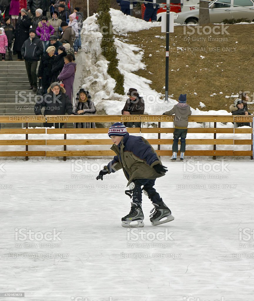 Boy at the city rink. stock photo