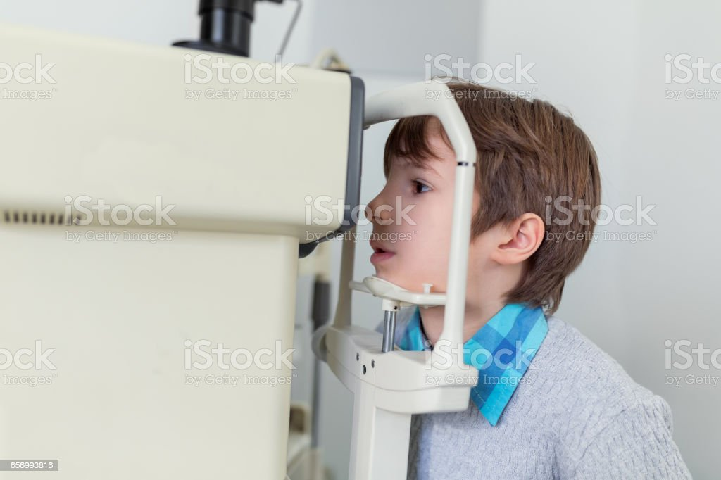 Boy at the eye doctor stock photo
