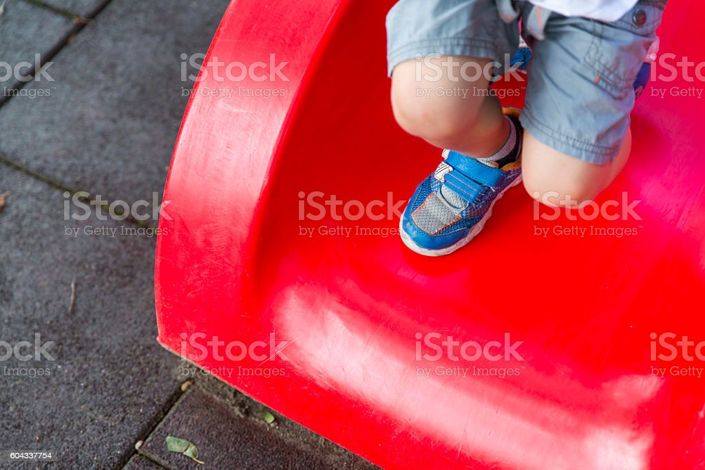 boy at the park playing stock photo