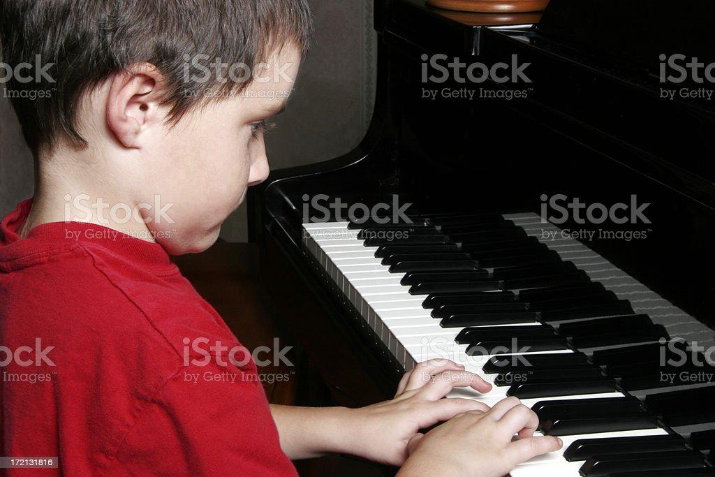 Boy at the piano royalty-free stock photo