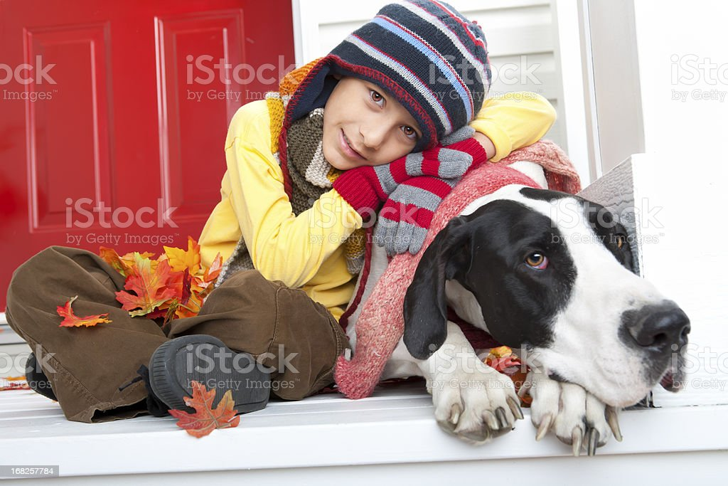 Boy autumn portrait with his dog royalty-free stock photo