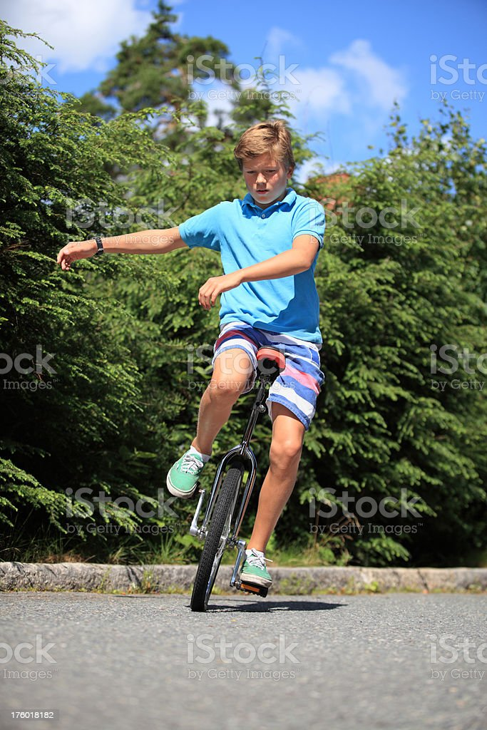 Boy balancing on a unicycle, Norway royalty-free stock photo