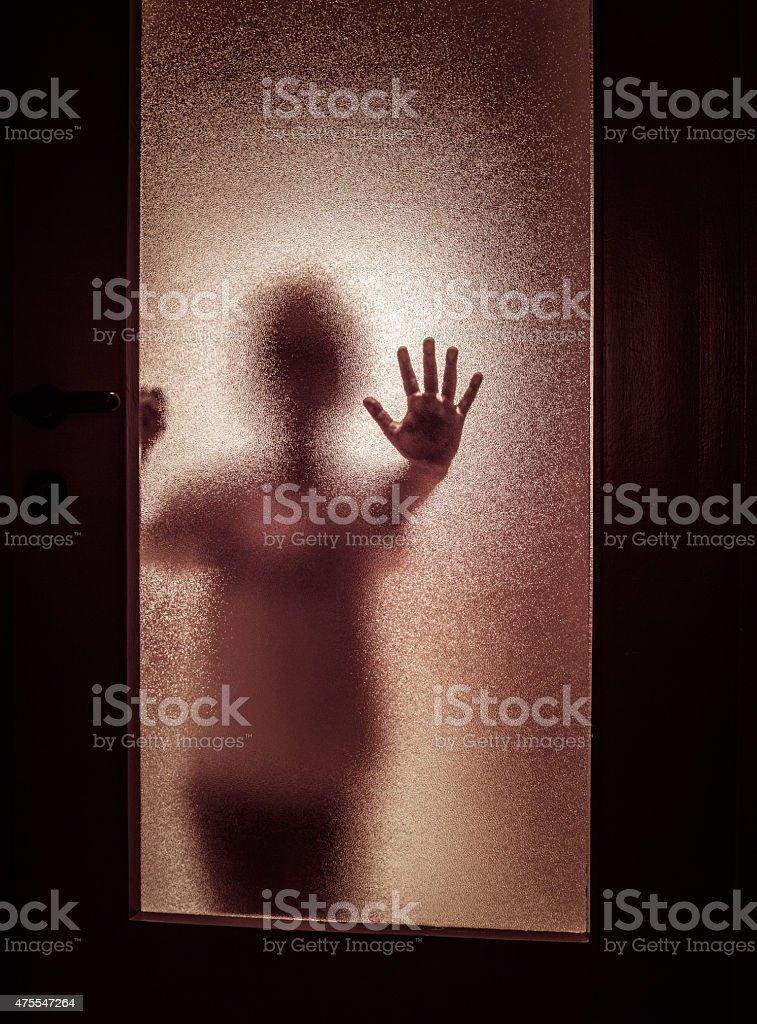 Boy Behind Door. Do Not Enter, Toned stock photo
