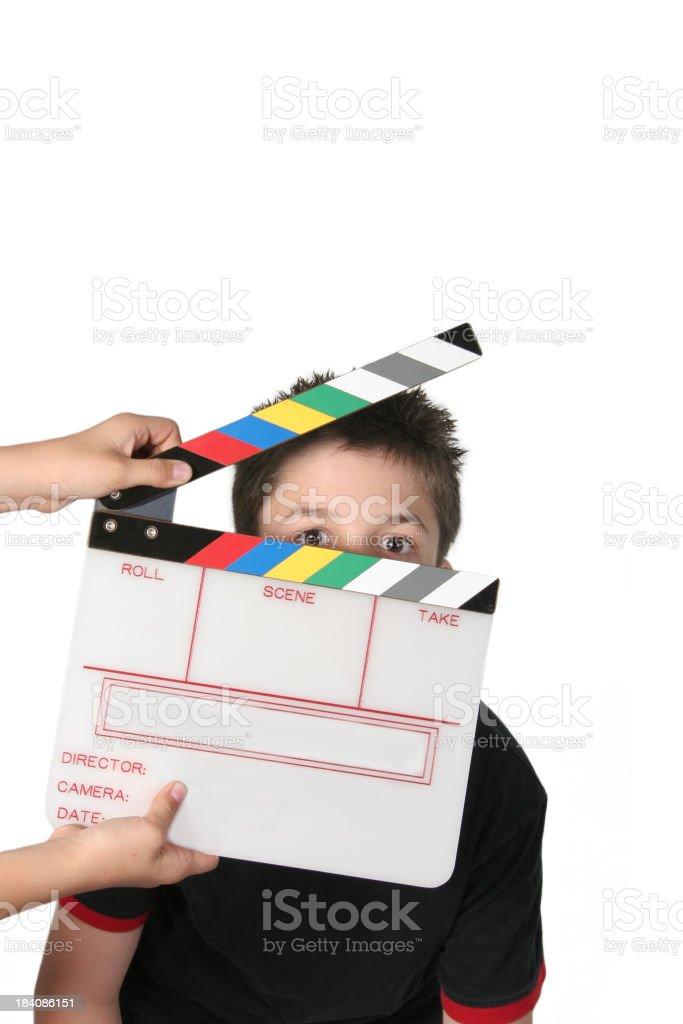 Boy behind Film Slate stock photo