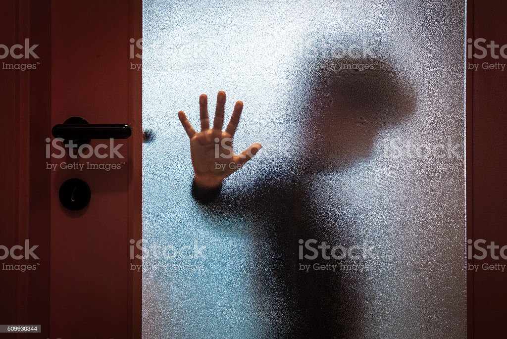 Boy Behind Glass Door stock photo