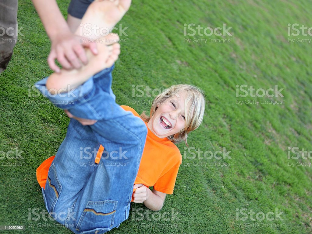 (PERSONAL REQUEST) boy being tickled stock photo