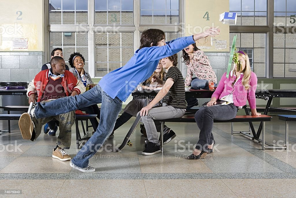 Boy being tripped up stock photo