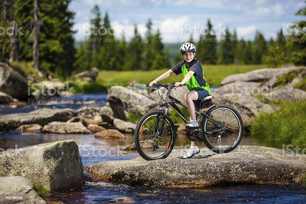 Boy biking royalty-free stock photo