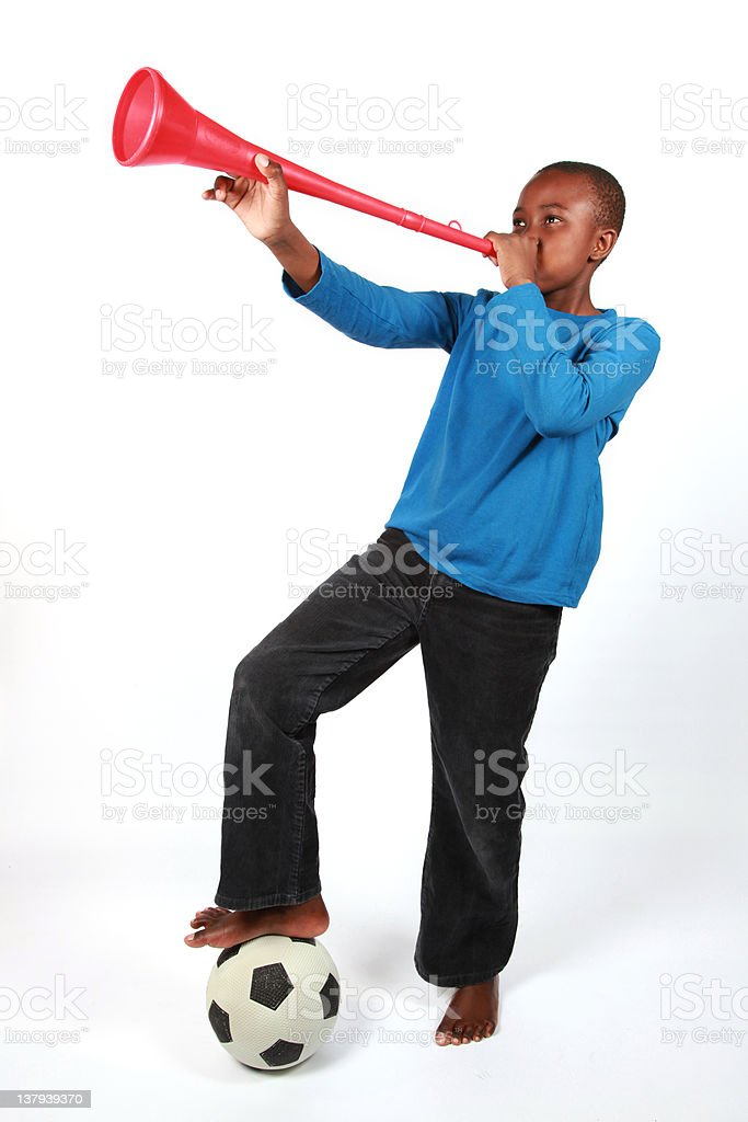 Boy Blowing Vuvuzela royalty-free stock photo