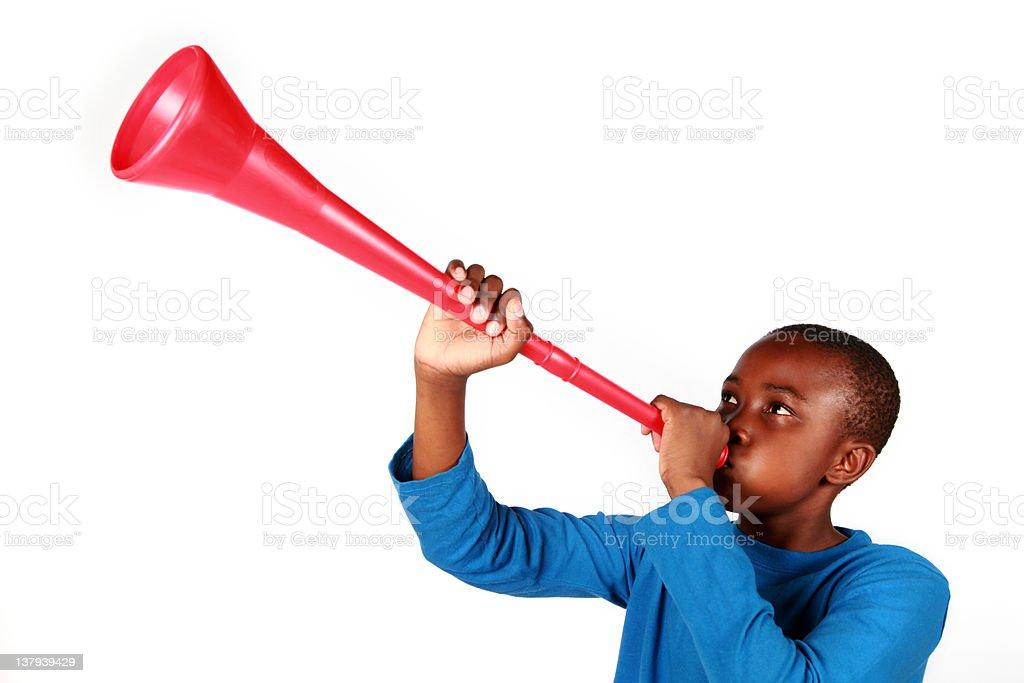 Boy Blowing Vuvuzela stock photo