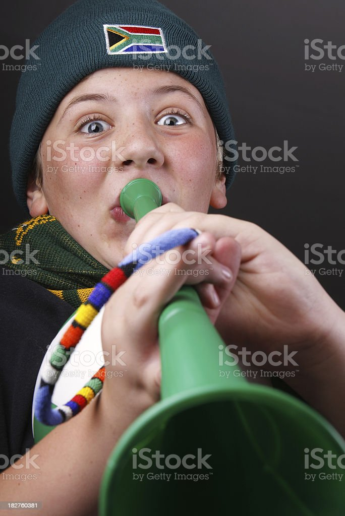 Boy blowing Vuvuzela South Africa stock photo