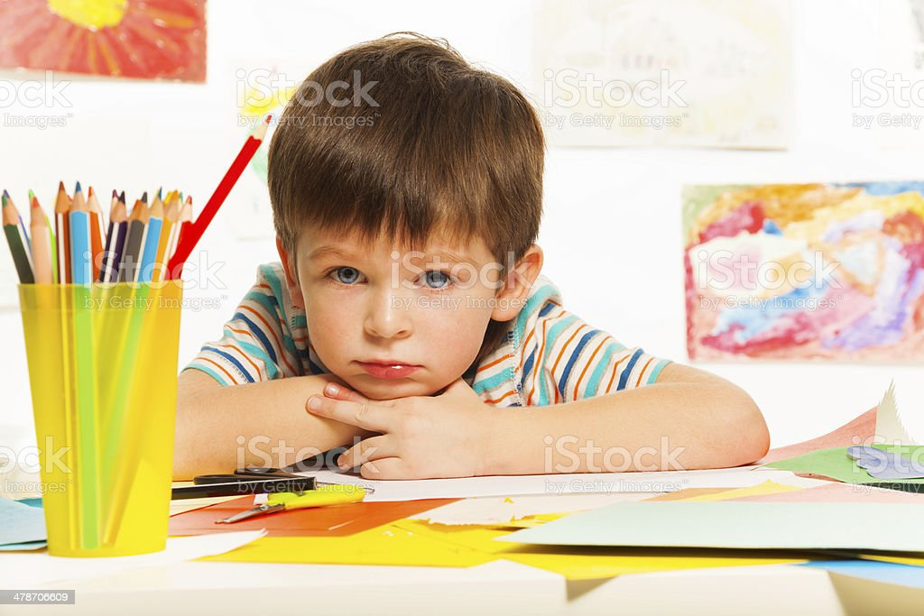 Boy bored in class stock photo