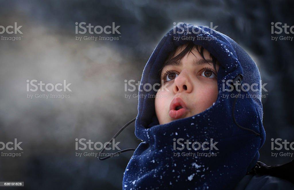 Boy breath in winter stock photo
