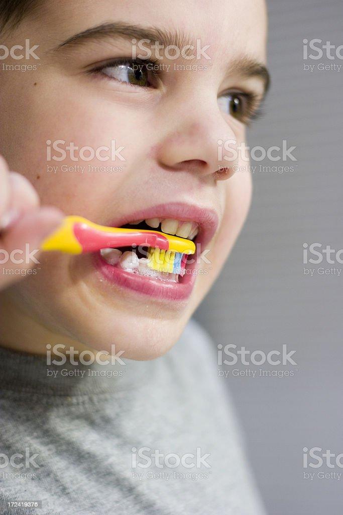 Boy brushes teeth stock photo