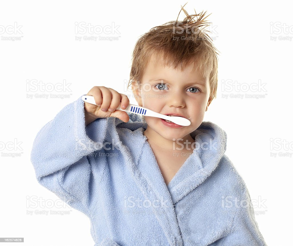 boy brushing his teeth royalty-free stock photo