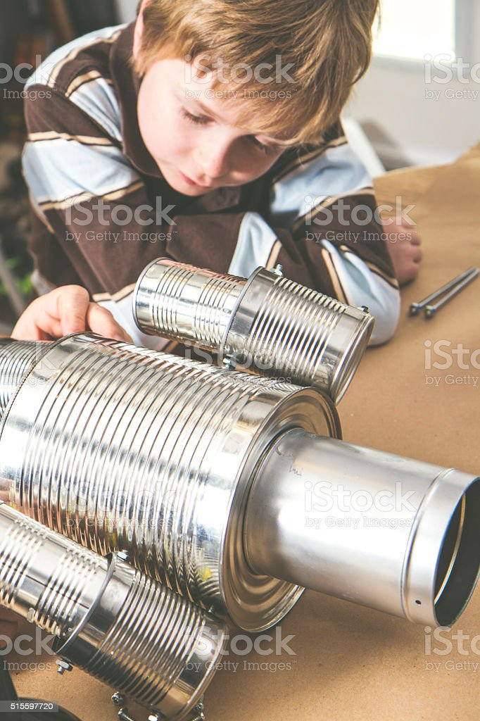 Boy Building Something With Recycled materials stock photo