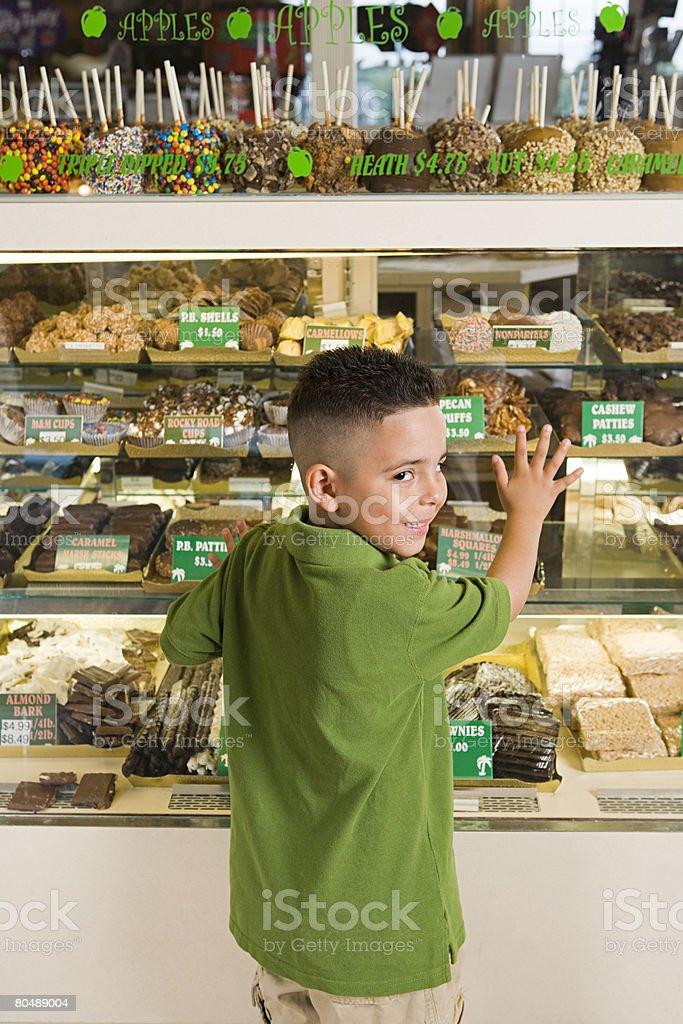 Boy by cake shop stock photo